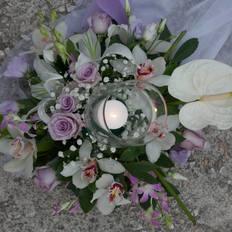 Γυάλες με λευκά κεριά